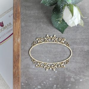 small decorative laser cut chipboard frame with large ornaments