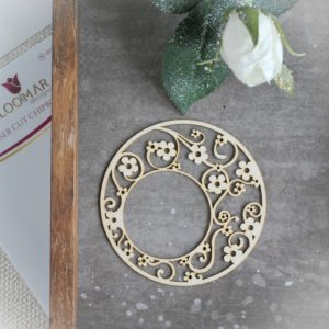 decorative laser cut chipboard round frame with lots of little flowers and swirls