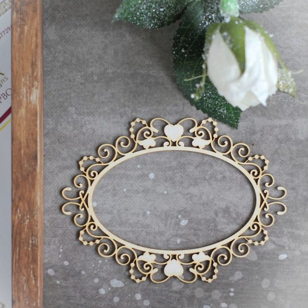 decorative laser cut chipboard oval frame with swirls and hearts