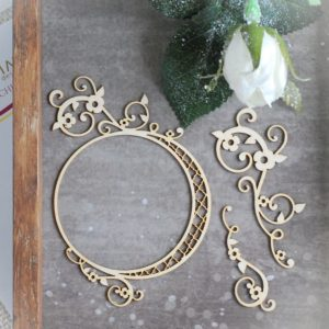 decorative laser cut chipboard frame with two floral swirls