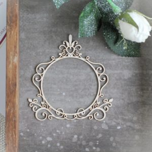 decorative laser cut chipboard frame with swirls leaves and ornament on the top