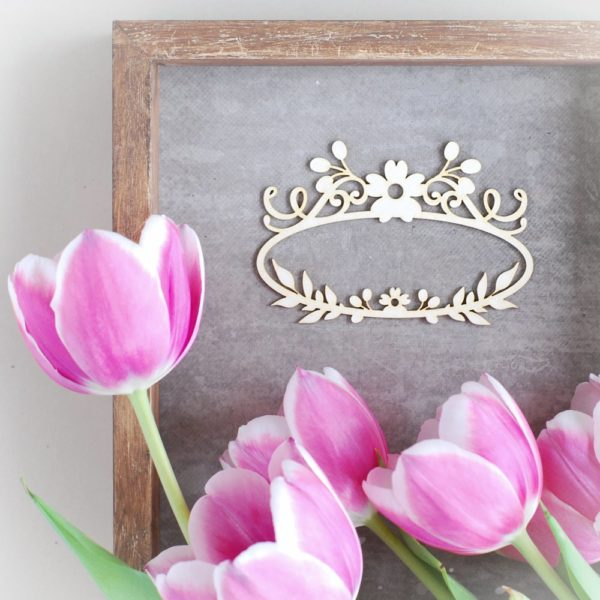 decorative laser cut chipboard oval frame with two flowers tiny leaves and swirls