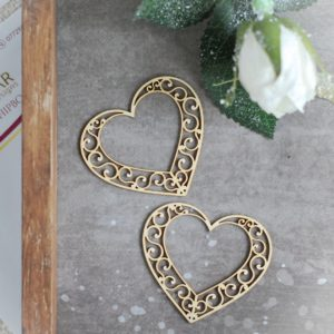 two decorative laser cut chipboard hearts with swirls