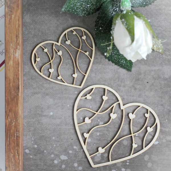 set of two decorative laser cut chipboard hearts with tiny hearts inside