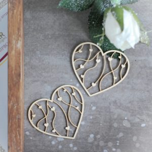 two small decorative laser cut chipboard hearts with tiny hearts inside