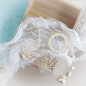 set of decorative laser cut chipboard elements shell seaweed anchor and lifebuay