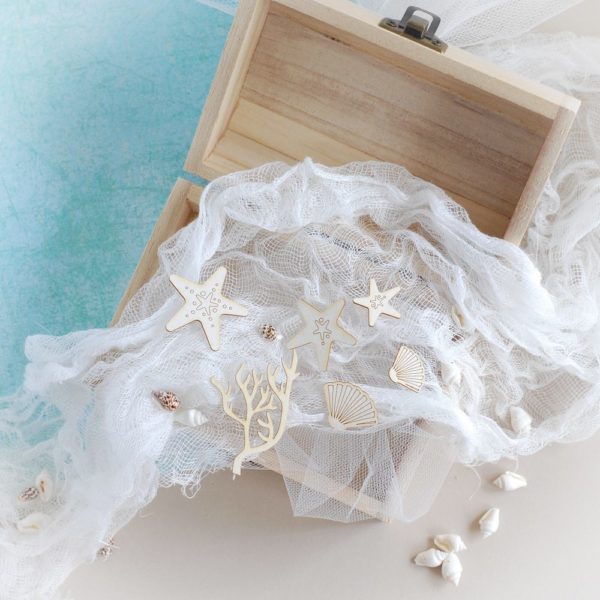 set of small decorative laser cut shells, seaweed and starfish