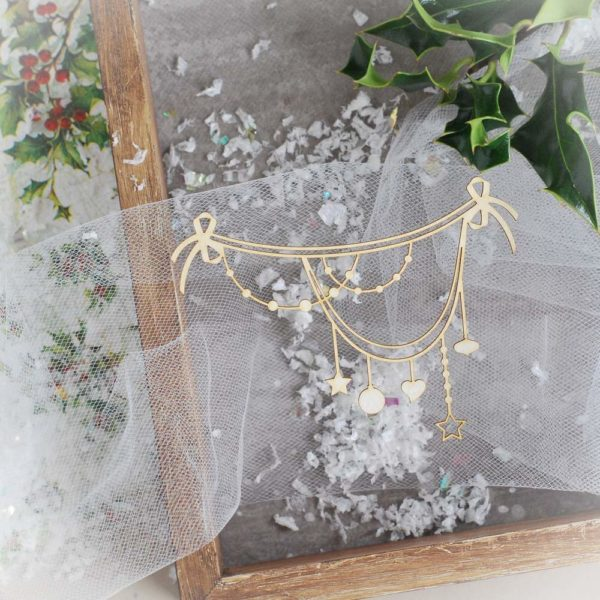 decorative laser cut chipboard garland with stars hearts and baubles
