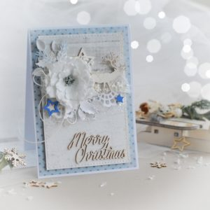 Merry christmas handmade card with reindeer, stars and flower