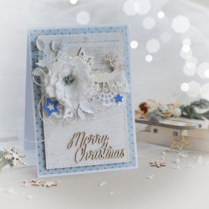Merry christmas handmade card with reindeer, stars and flower