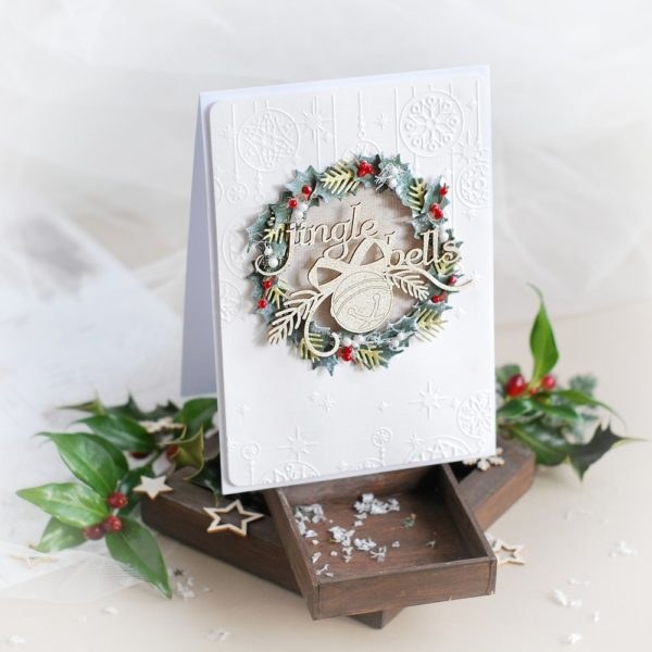 handmade christmas card with jingle bells wreath