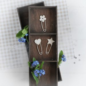 set of three decorative laser cut chipboard safety pins with heart star and flower
