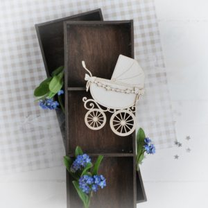decorative laser cut chipboard pram with star garland and bows