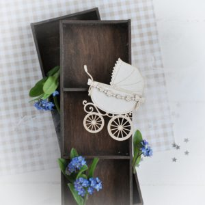 decorative laser cut chipboard pram with flower garland and bows