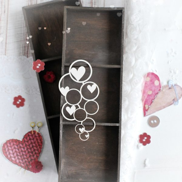 small decorative laser cut chipboard bubbles with hearts background